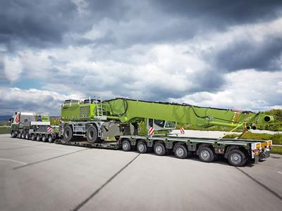 An impressive green convoy on the way to the Netherlands, with vessel deck, flat deck and elongation beams.