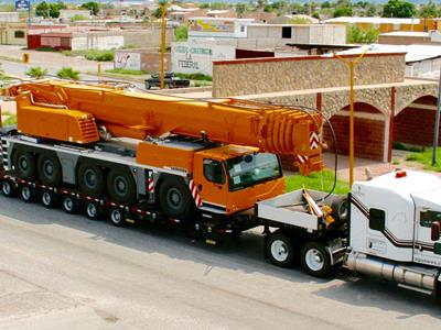 Transport of a mobile crane off-road truck on a Faymonville MultiMAX trailer