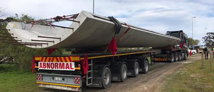 Absolute Wind and one of its flatbed trailers working in South Africa