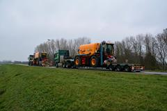 A fleet of agricultural machinery on lowbed trailers from Faymonville and MAX Trailer
